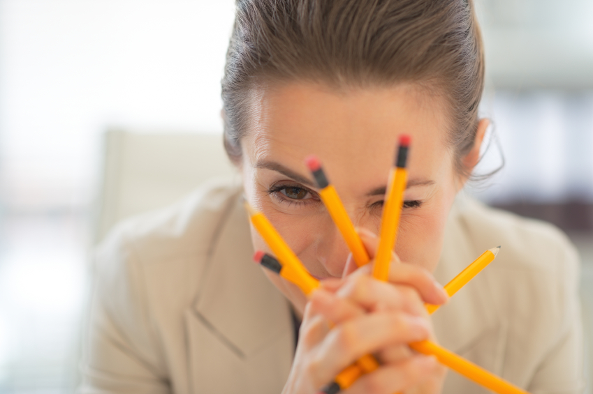 Business Woman holding pencils